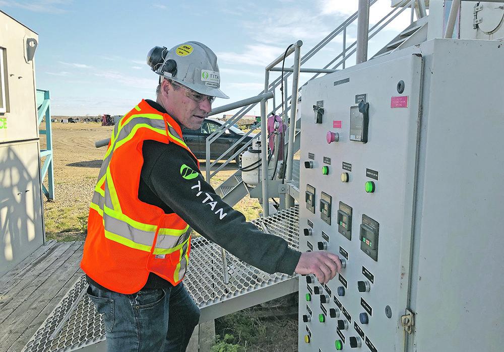 Jamie Bakos makes an adjustment at the pyrolysis facility near Craik, Sask.