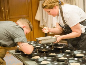 Members of Les Dames d'Escoffier B.C. Chapter prepare for a gala in the