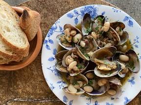 Manila clams, white bean and jamon XO created by Chef Jacob Kent of Como Taperia.