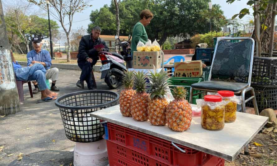 Farmers selling pineapples at a stall by the road in Kaohsiung, Taiwan