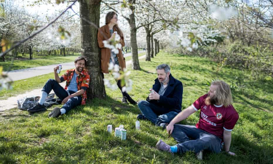 Rhik Samadder, sitting against the tree, with his friends Lauren, Tom and James.