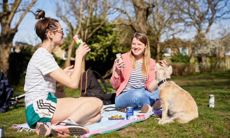 Felicity Cloake and her friend Emma enjoying canned cocktails in a London park.