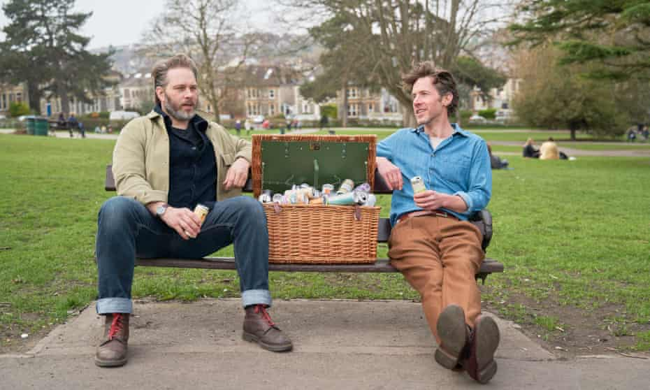 Richard Godwin, right, in Bristol with his friend Joe and a hamper full of canned drinks.